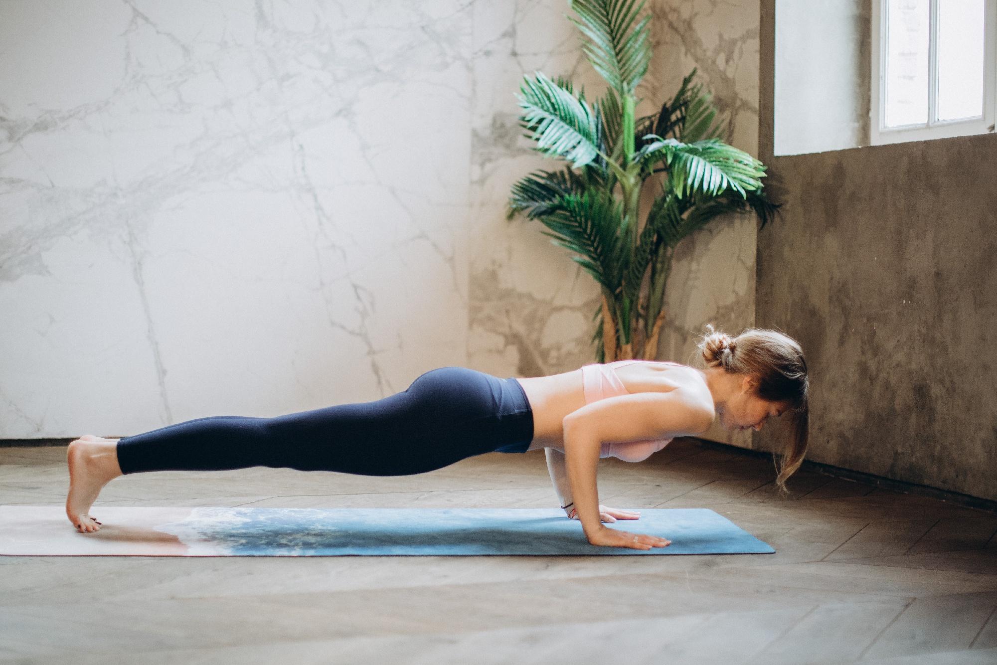 woman-in-black-tank-top-and-black-leggings-doing-yoga-3823063